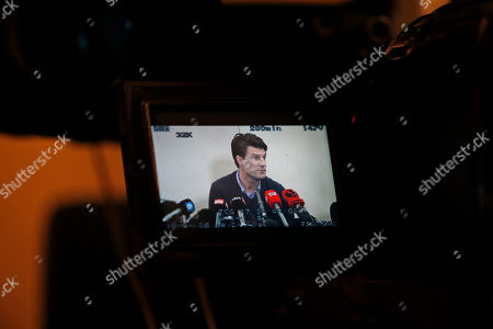 Michael Laudrup Danish soccer coach Michael Laudrup is seen on a camera's screen as he talks to members of the media during a news conference in west London, . Laudrup says he is considering taking legal action after being sacked as manager of Swansea City. The Dane, who led the Swans to League Cup success last year, added he had not been allowed to return to the training ground to say goodbye to staff. In a statement issued by the League Managers' Association (LMA), he claimed he is still waiting to hear the reasons why he was dismissed. 'I am, of course, taking legal advice,' he said