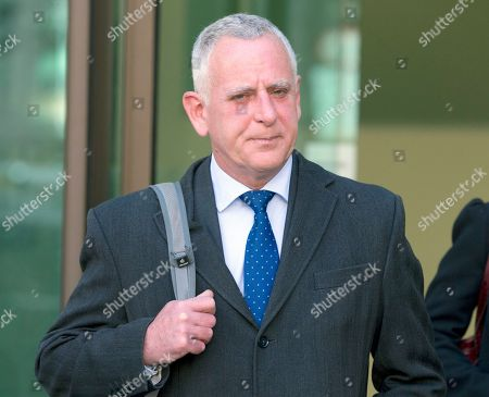 Stock Photo of Former Barclays Bank employee Peter Charles Johnson leaves Westminster Magistrates court after appearing on charges of conspiracy to defraud in relation to the manipulation of the dollar Libor rate in London