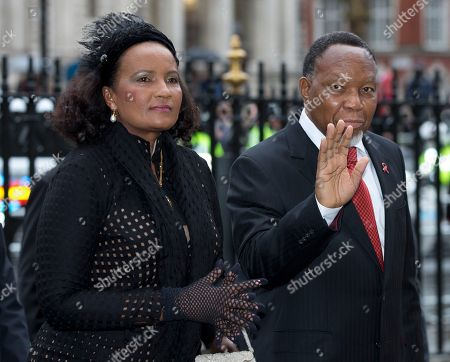 Deputy President of South Africa Kgalema Motlanthe, waves to the media as he arrives for the Nelson Mandela memorial service at Westminster Abbey in London Monday, March, 3, 2014. Mandela the former president of South Africa died in December 2013