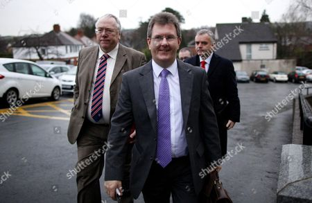 Democratic Unionist Party members Jeffrey Donaldson, center and Jonathan Bell, right, along with Mervyn Gibson, left, Senior member of the Orange Order arrive for the final day of political talks at the Stormont Hotel, Belfast, Northern Ireland, . U.S. envoy Richard Haass has resumed talks for the final day to resolve three contentious issues. A deadline for agreement on the talks about the past, parades and flags has been set for Monday evening