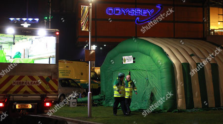 Ambulance crews attend a major incident after up to 60 people attending a concert at the Odyssey Arena, Belfast, Northern Ireland, were taken ill and treated for the effects of drugs and alcohol . The event goers were attending a dance event by Dutch DJ Hardwell