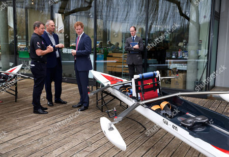 Stock Picture of Britain's Prince Harry, centre right, and British former rowing great Steven Redgrave, centre, listen to a member of Row to Recovery crew, left, at The River and Rowing Museum, on Henley on Thames, England, . Prince Harry met the Row to Recovery crew of wounded ex-servicemen who successfully rowed across the Atlantic in 2013. The Endeavour Fund, created by The Royal Foundation of The Duke and Duchess of Cambridge and Prince Harry, has supported Row to Recovery's legacy project to improve access to rowing facilities to aid recovery of wounded ex-servicemen and women