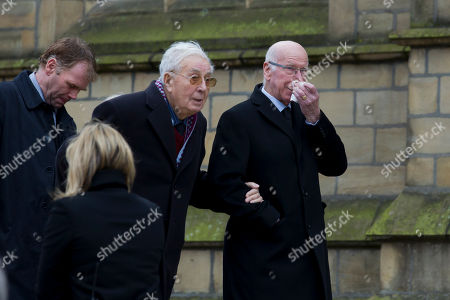 Aston Villa's former chairman Sir Doug Ellis, centre, arrives with former Manchester United and England player Sir Bobby Charlton, right, before a funeral service for the late Sir Tom Finney at Preston Minster, Preston, England, . The 91-year-old former England and Preston North End winger died on February 14 and was famous for his loyalty to his league club, Preston North End for whom he made 569 first-class appearances and for his performances in the English national side. AP Photo/Jon Super