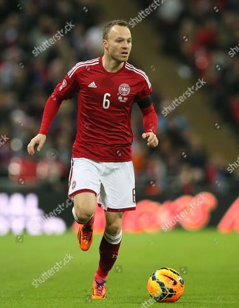 Lars Jacobsen Denmark's Lars Jacobsen runs with the ball during the international friendly soccer match between England and Denmark at Wembley stadium in London