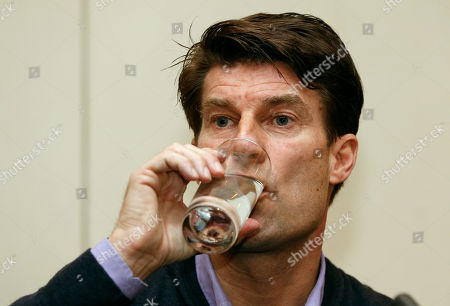 Michael Laudrup Danish soccer coach Michael Laudrup drinks water as he listens to a journalist's question during a news conference in west London, . Laudrup says he is considering taking legal action after being sacked as manager of Swansea City. The Dane, who led the Swans to League Cup success last year, added he had not been allowed to return to the training ground to say goodbye to staff. In a statement issued by the League Managers' Association (LMA), he claimed he is still waiting to hear the reasons why he was dismissed