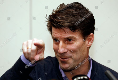 Michael Laudrup Danish soccer coach Michael Laudrup gestures as he talks to members of the media during a news conference in west London, . Laudrup says he is considering taking legal action after being sacked as manager of Swansea City. The Dane, who led the Swans to League Cup success last year, added he had not been allowed to return to the training ground to say goodbye to staff. In a statement issued by the League Managers' Association (LMA), he claimed he is still waiting to hear the reasons why he was dismissed