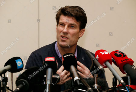 Michael Laudrup Danish soccer coach Michael Laudrup gestures as he talks to members of the media during a news conference in west London, . Laudrup says he is considering taking legal action after being sacked as manager of Swansea City. The Dane, who led the Swans to League Cup success last year, added he had not been allowed to return to the training ground to say goodbye to staff. In a statement issued by the League Managers' Association (LMA), he claimed he is still waiting to hear the reasons why he was dismissed. 'I am, of course, taking legal advice,' he said