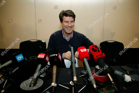 Michael Laudrup Danish soccer coach Michael Laudrup smiles to members of the media following a news conference in London, . Laudrup says he is considering taking legal action after being sacked as manager of Swansea City. The Dane, who led the Swans to League Cup success last year, added he had not been allowed to return to the training ground to say goodbye to staff. In a statement issued by the League Managers' Association (LMA), he claimed he is still waiting to hear the reasons why he was dismissed. 'I am, of course, taking legal advice,' he said