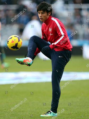 Arsenal's Ryo Miyaichi controls the ball ahead of their English Premier League soccer match against Newcastle United at St James' Park, Newcastle, England