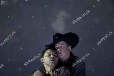 "Tom Randle, Daniel Okulitch On, American tenor Tom Randle (Jack Twist), left, and Canadian bass-baritone Daniel Okulitch (Ennis del Mar), right, perform during the press rehearsal of the production ""Brokeback Mountain"" at the Teatro Real, in Madrid, Spain. It was a short story, then a Hollywood movie. Now the tragic tale of cowboys in love is being reinvented again: Brokeback Mountain _ the opera. Ahead of its world premiere in Madrid, author Annie Proulx told The Associated Press that the form of opera presented an opportunity to explore the complexities of the tale in a way neither her own short story nor the movie by director Ang Lee were able to do"