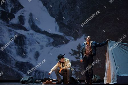 "Tom Randle, Daniel Okulitch On, American tenor Tom Randle (Jack Twist), right, and Canadian bass-baritone Daniel Okulitch (Ennis del Mar), left, perform during the press rehearsal of the production ""Brokeback Mountain"" at the Teatro Real, in Madrid, Spain. It was a short story, then a Hollywood movie. Now the tragic tale of cowboys in love is being reinvented again: Brokeback Mountain _ the opera. Ahead of its world premiere in Madrid, author Annie Proulx told The Associated Press that the form of opera presented an opportunity to explore the complexities of the tale in a way neither her own short story nor the movie by director Ang Lee were able to do"