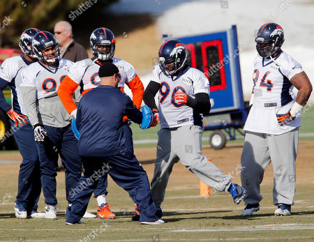 Shaun Phillips Denver Broncos defensive end Shaun Phillips (90) works on drills as other defensive linemen look on during practice for the football team's NFL playoff game against the San Diego Chargers at the Broncos training facility in Englewood, Colo., on