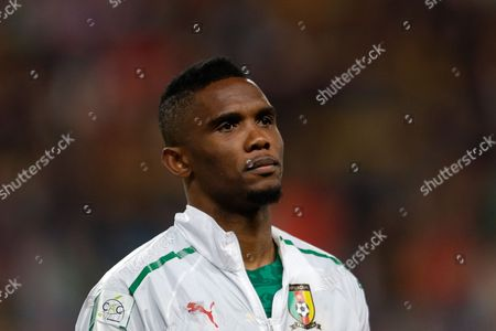 """Samuel Eto'o Cameroon's Samuel Eto'o listens to the national anthems before their friendly soccer match with Portugal, in Leiria, Portugal. Samuel Eto'o says he is retiring from international football days after being left out of Cameroon's latest squad and stripped of the captaincy. The 33-year-old forward made the announcement Wednesday on his Facebook page, saying """"I wish to thank all Africans in particular and all my fans around the world for their love and unconditional support"""