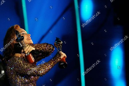 Paloma San Basilio Spanish singer Paloma San Basilio holds up her Silver and Gold Torch awards at the Vina del Mar International Song Festival in Vina del Mar, Chile, . Believed to be one of the largest musical events in Latin America, the annual weeklong festival was first inaugurated in 1960