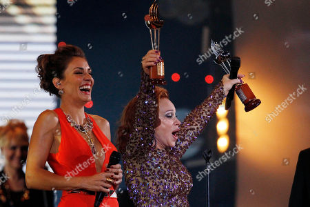 Paloma San Basilio Paloma San Basilio holds up her torch of silver and gold torch awards at the Vina del Mar International Song Festival in Vina del Mar, Chile. The festival organizers announced, that after 33 years of tradition they will no longer give the festival's famous golden and silver torch awards to participating artists