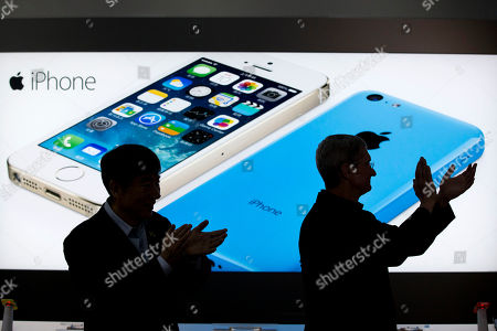 Tim Cook, Xi Guohua Apple CEO Tim Cook, right, and China Mobile's chairman Xi Guohua are silhouetted against a screen showing iPhone products as they applaud during a promotional event that marks the opening day of sales of China Mobile's 4G iPhone 5s and iPhone 5c at a shop of the world's largest mobile phone operator in Beijing, China. The high-stakes battle between the world's largest smartphone makers is scheduled to wrap up this week after a monthlong trial that has pulled the curtain back on just how very cutthroat the competition is between Apple and Samsung. Closing arguments in the patent-infringement case are scheduled to begin Monday, April 28 with the two tech giants accusing each other, once again, of ripping off designs and features. At stake: $2 billion if Samsung loses, a few hundred million if Apple loses