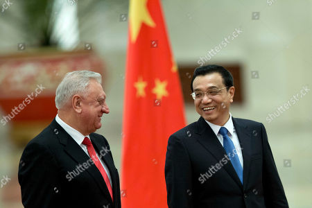 Li Keqiang, Mikhail Myasnikovich Chinese Premier Li Keqiang, right, and his Belarus' counterpart Mikhail Myasnikovich laugh during a welcome ceremony held at the Great Hall of the People in Beijing