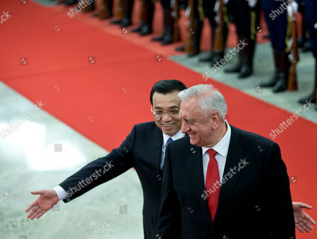 Li Keqiang, Mikhail Myasnikovich Chinese Premier Li Keqiang, left, gestures to lead his Belarus' counterpart Mikhail Myasnikovich during a welcome ceremony at the Great Hall of the People in Beijing