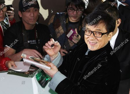 """Jackie Chan Hong Kong actor and director Jackie Chan signs autographs for fans during a promotional event for his latest movie """"Police Story 2014"""" in Seoul, South Korea. Chan said he feels shame for his son, who has been indicted by Beijing prosecutors on a drug charge and could be jailed for up to three years. The remarks, reported Wednesday, Dec. 24 by China's official Xinhua News Agency, came two days after authorities announced the indictment against Jaycee Chan, 32, who is charged with sheltering others to use drugs"""
