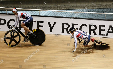 Great Britain's Jessica Varnish, right, falls during women's sprint quarterfinals as teammate Rebecca James, left, looks, during the Track Cycling World Championships in Cali, Colombia