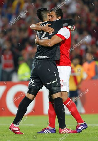 Camilo Vargas, Jose De La Cuesta Jose De La Cuesta of Colombia's Independiente Santa Fe, right, and goalkeeper Camilo Vargas embrace at the end of their Copa Libertadores soccer match against Mexico's Monarcas in Bogota, Colombia, . The match ended 2-2 on aggregated, advancing Santa Fe to the next round