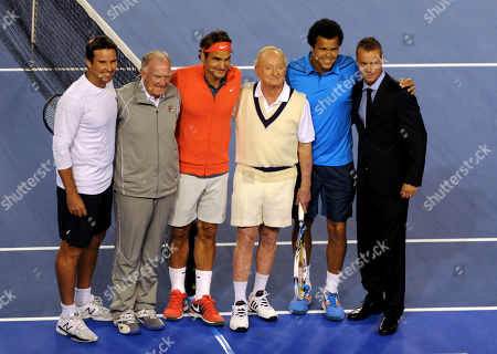 Pat Rafter, Tony Roche, Roger Federer, Rod Laver, Jo-Wilfried Tsonga, Lleyton Hewitt Roger Federer, third left, of Switzerland, Jo-Wilfried Tsonga, second right, of France and Lleyton Hewitt, right, of Australia, pose with former Australian tennis greats, Tony Roche, second left, Rod Laver, third right, and Pat Rafter, left, during a gala charity exhibition match in the lead up to the Australian Open at Rod Laver Arena in Melbourne, Australia, . The charity event for the Roger Federer Foundation and the Australian Tennis Foundation will raise money for the education of African children
