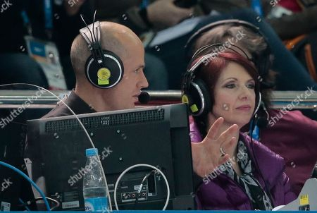 Scott Hamilton CORRECTS COMMENTATOR TO KURT BROWNING OF CBC, INSTEAD OF SCOTT HAMILTON OF NBC. REMOVES REFERENCES TO HAMILTON'S CAREER - In this photo, figure skating commentator Kurt Browning speaks with his colleague for CBC television during the men's short program figure skating competition at the 2014 Winter Olympics in Sochi, Russia