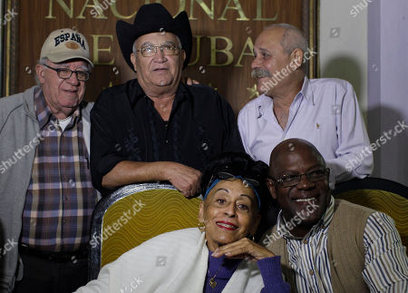"Omara Portuondo, Jesus Aguaje Ramos, Luis Manuel Guajiro Mirabal, Eliades Ochoa, Barbarito Torres The remaining members of Cuba's Buena Vista Social Club band, Omara Portuondo, 81, front left, Jesus Aguaje Ramos, 63, front right, Luis Manuel Guajiro Mirabal, 80, back left, Eliades Ochoa, 68, back center, and Barbarito Torres, 60 pose for a picture after a press conference at the Hotel Nacional in Havana, Cuba, . The Buena Vista Social Club has joined together for a their last worldwide tour under the name ""Adios Tour"". The tour begins in June 2014 in Europe and ends in Havana in late October 2015 with a concert at the Karl Marx theater"