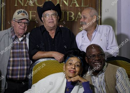 Omara Portuondo, Jesus Aguaje Ramos, Luis Manuel Guajiro Mirabal, Eliades Ochoa, Barbarito Torres Remaining members of Cubaís Buena Vista Social Club band, Omara Portuondo, 81, front left, Jesus Aguaje Ramos, 63, front right, Luis Manuel Guajiro Mirabal, 80, back left, Eliades Ochoa, 68, back center, and Barbarito Torres, 60 pose for a picture after a press conference at the Hotel Nacional in Havana, Cuba. The Buena Vista Social Club has joined together for a their last worldwide tour under the name ìAdios Tourî. The tour begins in June 2014 in Europe and ends in Havana in late October 2015 with a concert at the Karl Marx theater