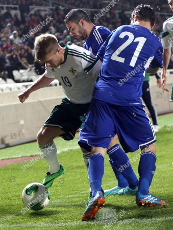 Vincent Laban, Konstantinos Makridis, Jamie Ward Cyprus' Vincent Laban, right, and Konstantinos Makridis, back, fights for the ball with Jamie Ward, of Northern Ireland during their friendly soccer match at GSP stadium in Nicosia, Cyprus