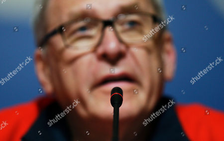 Michael Vesper A microphone stands in front of Michael Vesper, director general of the German Olympic Sports Confederation, as he speaks at a press conference in response to a top German biathlete testing positive for doping at the 2014 Winter Olympics, in Sochi, Russia