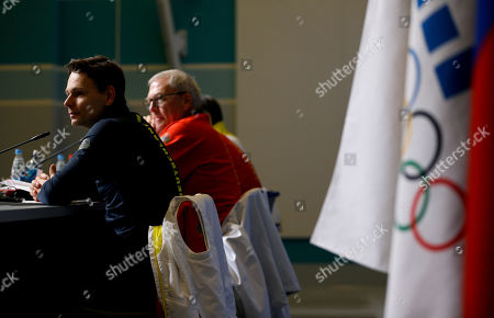 Michael Vesper, Christian Klaue Christian Klaue, spokesman for the German Olympic Sports Confederation, left, and Director General Michael Vesper, sit during a press conference in response to a top German biathlete testing positive for doping at the 2014 Winter Olympics, in Sochi, Russia