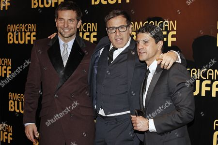 "Bradley Cooper, David O. Russell, Said Taghmaoui U.S actor Bradley Cooper, left, director David O. Russell, center, and French actor Said Taghmaoui pose for photographers prior to the screening of ""American Hustle"", in Paris"