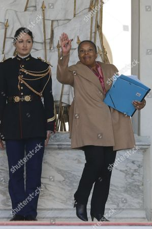 French justice minister Christine Taubira leaves at the end of the Cabinet meeting at the Elysee Palace in Paris . Christiane Taubira dismissed an accusation by France's opposition conservatives saying she had not been aware that ex-president Nicolas Sarkozy's phone was being tapped until it was publicly revealed by Le Monde newspaper last week