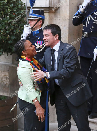 Stock Picture of French Interior Minister Manuel Vals greets Justice Minister Christaine Taubira, left, at the Interior ministry for the traditional New Year breakfast with government members in Paris