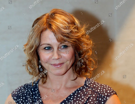 Stock Photo of Danish actress Anne Louise Hassing poses for photographers as she arrives at the screening premiere of Goltzius and the Pelican Company by British film director Peter Greenaway, in Paris