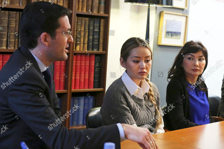 Peter Sahlas, left, the US lawyer representing Mukhtar Ablyazov speaks as his wife Alma Shalabayeva, right, and daughter Madina Ablyazova, centre listen, during a press conference, in Paris . An opposition leader from a country that has been ruled by the same man since 1989, a former banker accused of siphoning off billions, Mukhtar Ablyazov has been jailed since police special forces seized him July 31 in the south of France