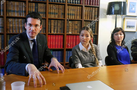 Peter Sahlas, left, the US lawyer representing Mukhtar Ablyazov speaks as his wife Alma Shalabayeva, right, and daughter Madina Ablyazova, centre listen, during a press conference, in Paris, . An opposition leader from a country that has been ruled by the same man since 1989, a former banker accused of siphoning off billions, Mukhtar Ablyazov has been jailed since police special forces seized him July 31 in the south of France