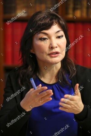 Mukhtar Ablyazov's wife Alma Shalabayeva, talks, during a press conference, in Paris, . An opposition leader from a country that has been ruled by the same man since 1989, a former banker accused of siphoning off billions, Mukhtar Ablyazov has been jailed since police special forces seized him July 31 in the south of France