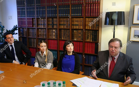 Jean Pierre Mignard, right, and Peter Sahlas, left, the lawyers representing Mukhtar Ablyazov sit with his wife Alma Shalabayeva, centre right, and daughter Madina Ablyazova, centre left, during a press conference, in Paris, . An opposition leader from a country that has been ruled by the same man since 1989, a former banker accused of siphoning off billions, Mukhtar Ablyazov has been jailed since police special forces seized him July 31 in the south of France