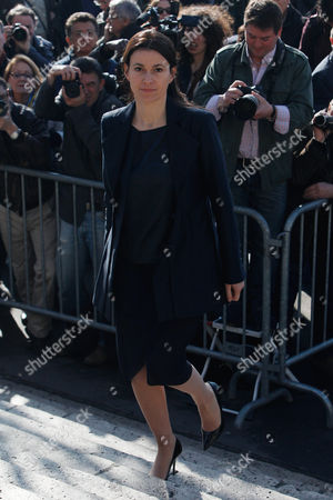 French Culture Minister Aurelie Filippetti arrives to attend the funeral of French director Alain Resnais in the Saint Vincent de Paul church in Paris, . The French director died at age 91 on march 1, 2014, in Paris