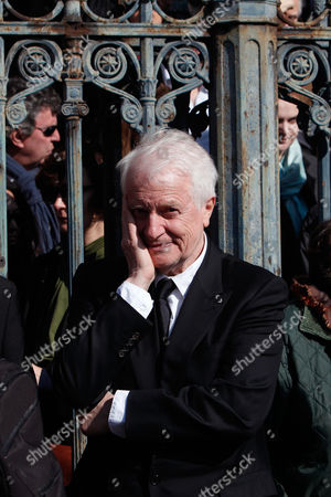 French actor Andre Dussollier attends the funeral of French director Alain Resnais in the Saint Vincent de Paul church in Paris, . The French director died at age 91 on march 1, 2014, in Paris
