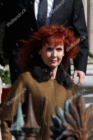 French actress and Alain Resnais' wife, Sabine Azema follows the coffin of late French director Resnais, at the at the end of the funeral service for Resnais, in the Saint Vincent de Paul church in Paris, . The French director died at age 91 on March 1, 2014, in Paris