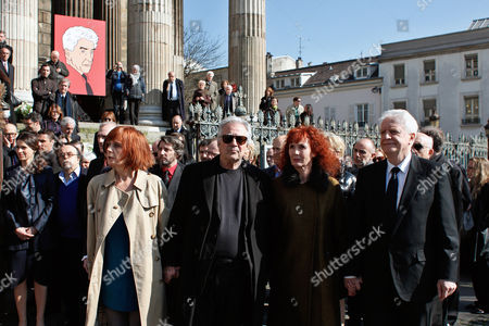 French actress and Alain Resnais' wife, Sabine Azema, second from right, actors Andre Dussolier, right, and Pierre Arditi, third from right, pay respect at the end of the funeral service for Alain Resnais in the Saint Vincent de Paul church in Paris, . The French director died at age 91 on March 1, 2014, in Paris