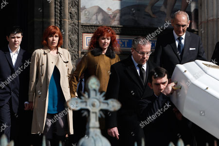 French actress and Alain Resnais' wife, Sabine Azema, center, follows the coffin of late French director Alain Resnais, at the end of the funeral service for Resnais in the Saint Vincent de Paul church in Paris, . The French director died at age 91 on March 1, 2014, in Paris