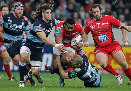 Mathieu Bastareau, Gavin Evans, Josh Navidi Toulon's Mathieu Bastareau, center, is tackled by Cardiff's Gavin Evans, right, and Josh Navidi during their Heineken European Cup rugby match, in Nice, southeastern France, . The winner of his pool 2 clash will qualify for the H Cup quarter final