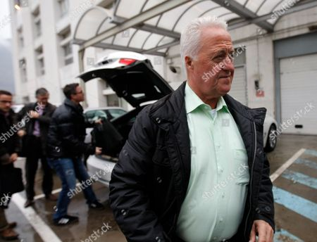 Rolf Schumacher, Ralf Schumacher Michael Schumacher's father Rolf, right, and brother Ralf, arrive at Grenoble hospital, French Alps, where former seven-time Formula One champion Michael Schumacher is being treated after sustaining a head injury during a ski accident. Schumacher has been in a medically induced coma since Sunday, when he struck his head on a rock while on a family vacation