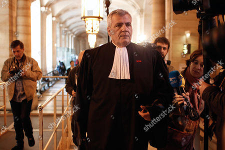 Former French President Nicolas Sarkozy's lawyer, Thierry Herzog, arrives at the Paris court house, . Former French President Nicolas Sarkozy and his singer-songwriter wife Carla Bruni are asking a judge for an emergency injunction Monday March 10, 2014, barring any publication of private conversations secretly recorded by former aide Patrick Buisson, also including discussions between Sarkozy and his inner circle. Buisson made the recordings, which his lawyer said were to help the aide keep accurate records