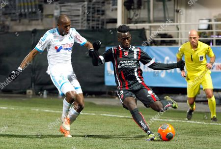 Rod Fanni, Arthur Masuaku Marseille's defender Rod Fanni, left, challenges for the ball with Valenciennes' Arthur Masuaku, during their League One soccer match, at the Velodrome Stadium, in Marseille, southern France
