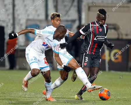 Arthur Masuaku, Benjamin Mendy, Rod Fanni Valenciennes' Arthur Masuaku, right, challenges for the ball with Marseille's Benjamin Mendy, center and Rod Fanni, during their League One soccer match, at the Velodrome Stadium, in Marseille, southern France